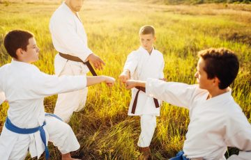 Junior Karate Team With Instructor On Training